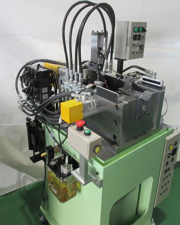 サブクランプ付き端末加工機